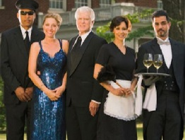 Wealthy couple with servants